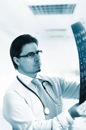 Medical doctor is examining a computer tomograph image.