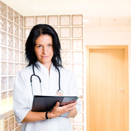 Attractive female doctor looks at the camera. Stock Photo - 4089979