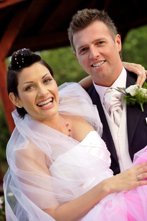Wedding bride and groom togehter outdoors, smiling, portrait. photo