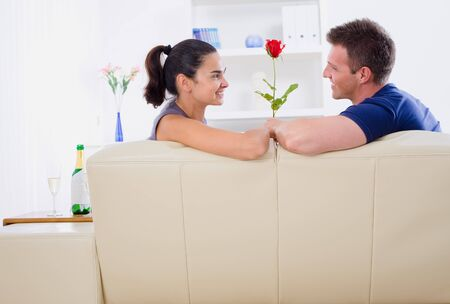 Romantic man giving red rose to woman - Valentine's Day. Stock Photo - 4087749