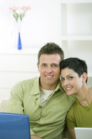 Love couple working together on laptop computer at home. photo