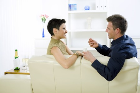 Man giving engagement ring to woman at home, smiling. Stock Photo - 4087750