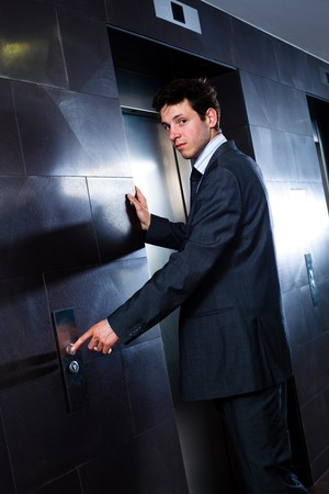 Young hapy businessman standing at office in front of elevator. Stock Photo - 4107063