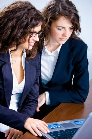Young businesswomen working together in business team on laptop computer in meeting room at office. Stock Photo