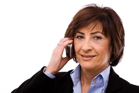 Portrait of senior executive businesswoman, white background. photo
