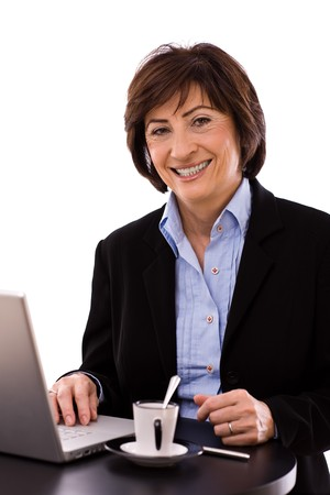 Portrait of senior executive businesswoman, white background. photo