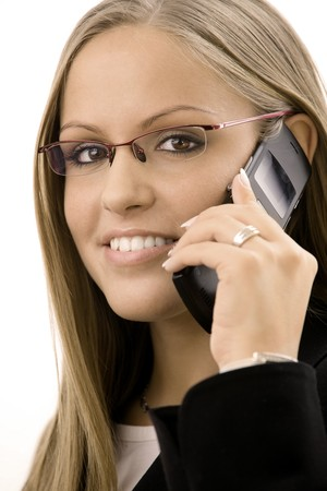 mobilephones: Young happy businesswoman calling on mobile phone, isolated on white. Stock Photo