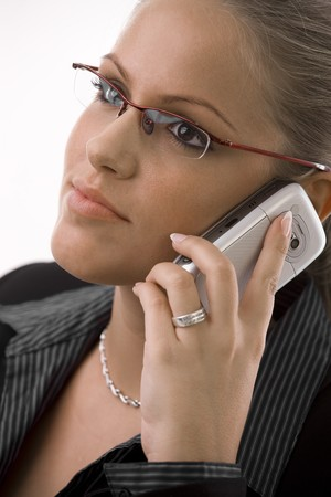 Young happy businesswoman calling on mobile phone, isolated on white. Stock Photo - 4105374