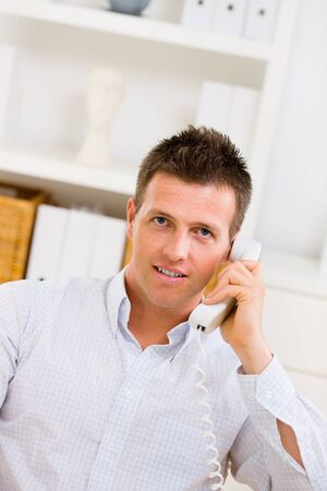 Business man working at home, calling on phone. Stock Photo - 4121307