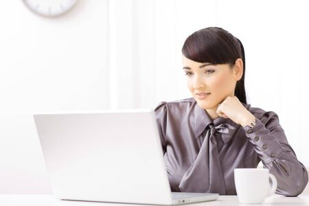Young businesswoman thinking over her laptop. Stock Photo - 4121263