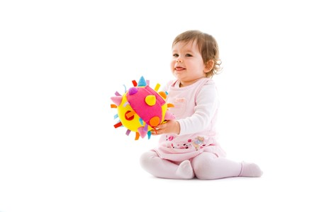 Happy baby girl sitting on floor playing with toy smiling, isolated on white background. Stock Photo - 4121309