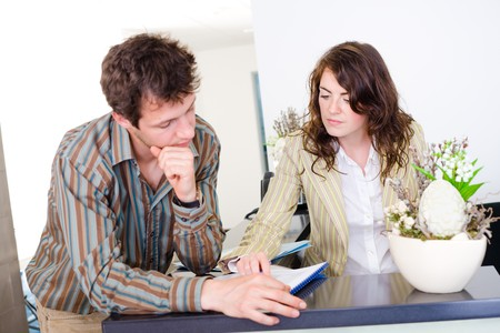 Young businesspeople having discussion at office reception. Stock Photo
