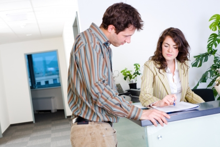 Young businesspeople having discussion at office reception. Stock Photo - 4130571