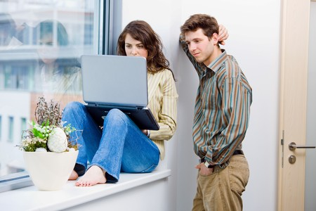 Male and female office workers talking and brainstorming at office, using laptop computer.  photo