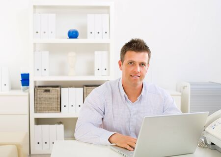 Business man working on laptop computer at home. Stock Photo - 4130447