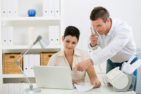Happy couple working at home office running small business. Stock Photo - 4130531