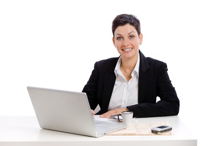 Businesswoman working at desk, isolated on white. Stock Photo - 4130434