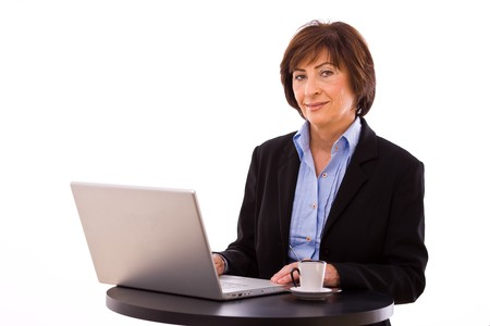 Senior businesswoman working on laptop computer at coffee table. Stock Photo - 4130689