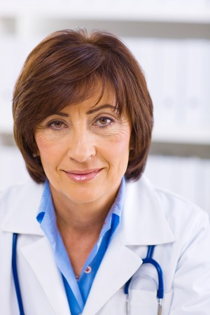 Portrait of senior female doctor working at office. Stock Photo - 4130705
