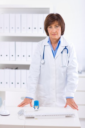 Portrait of senior female doctor working at office. Stock Photo - 4130686