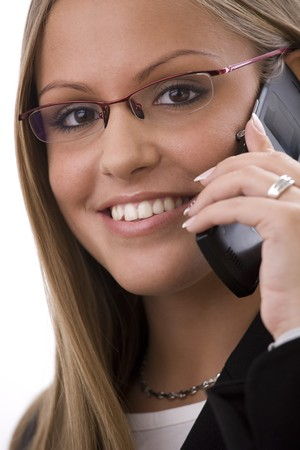 Young happy businesswoman calling on mobile phone, isolated on white. photo
