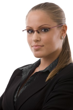 Young happy business woman in glasses, smiling, white background. photo