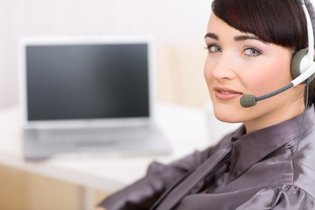Young female operator wearing a headset looking at camera. Stock Photo - 4130697