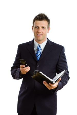 businesswear: Happy businessman  calling on cellphone, smiling, isolated on white.