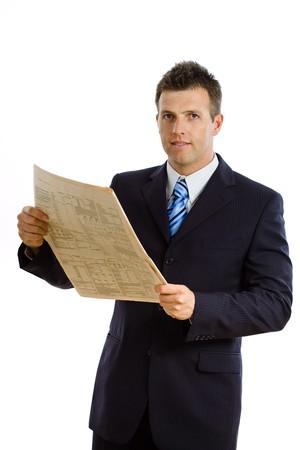 financial newspaper: Happy businessman reading financial newspaper, smiling, isolated on white.