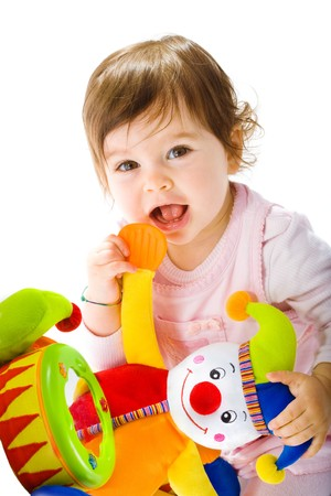 soft toy: Happy baby girl playing with toy clown smiling, cotout on white background. Stock Photo
