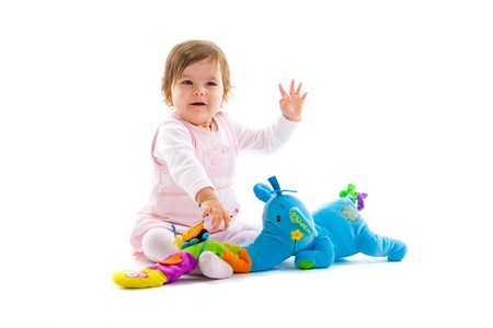Happy baby girl sitting on floor playing with toy smiling, isolated on white background. Stock Photo - 4153271