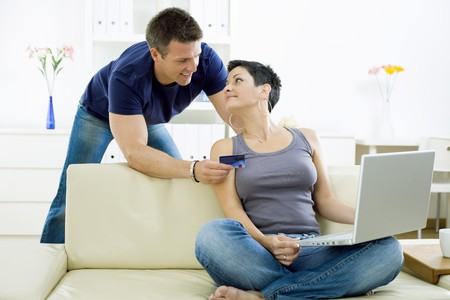 Couple shopping on internet paying by credit card. photo