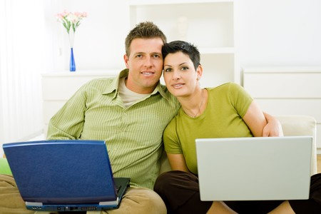 Love couple working together on laptop computer at home. Stock Photo - 4153347