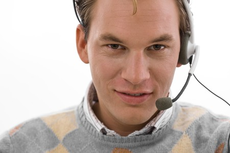 Smiling male customer service operator in headset, white background. Stock Photo - 4161086