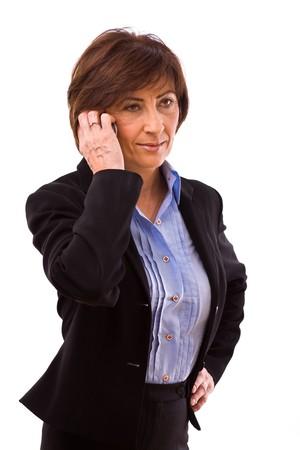 Senior businesswoman calling on mobile phone isolated on white background. photo