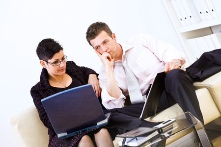 Businesspeople sitting on sofa at office and working together on laptop computer. Stock Photo - 4161227