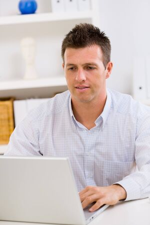 Business man working on laptop computer at home. Stock Photo - 4161223