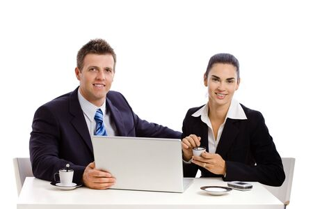 Business people working on laptop at desk, white background. Stock Photo - 4161154