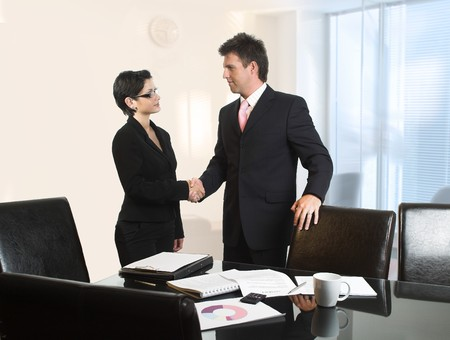 successfull: Young business people are shaking hands after a business deal.