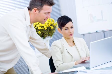 Business couple working together at office. photo