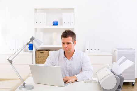 Business man working on laptop computer at home. Stock Photo - 4175667
