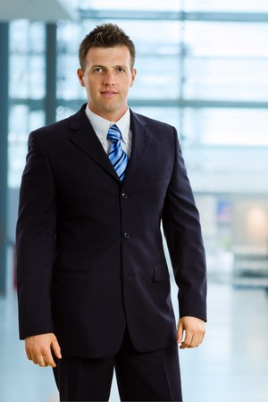 Happy businessman smiling at office lobby. photo