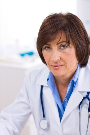 Portrait of senior female doctor working at office. Stock Photo - 4175675