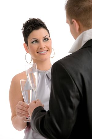 Happy young couple drinking champagne, smiling. photo