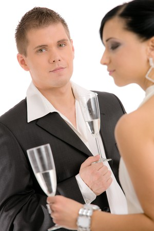 Happy young couple drinking champagne, smiling. Stock Photo - 4175694