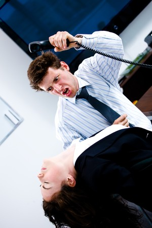 violence in the workplace: Flustrated businessman brutally attacking businesswomen at office, angry.