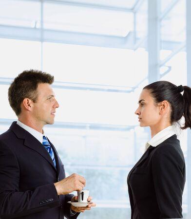 coffe break: Businesspeople having coffe break and talking at office. Stock Photo
