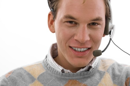 Smiling male customer service operator in headset, white background. Stock Photo - 4204760