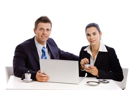 Business people working on laptop at desk, white background. photo