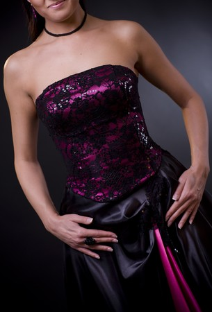 Photo of a purple, laced coktail dress with black skirt. photo